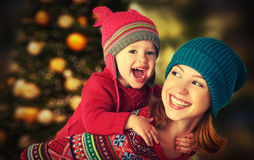 Happy Family Mother And Little Daughter Playing In The Winter For Christmas Stock Photos
