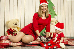 Happy family of mother and baby on Christmas Stock Photography