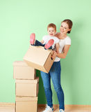 Happy family mother and baby daughter in an empty apartment with Royalty Free Stock Photos