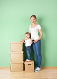 Happy family mother and baby daughter in an empty apartment with Stock Images