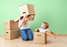 Happy family mother and baby daughter in an empty apartment wit Stock Photos