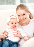 Happy family. Mother and baby daughter at home on the sofa Stock Photography