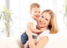 Happy family. Mother and baby daughter at home Stock Photography