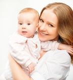 Happy family mother and baby daughter hugging Stock Photography