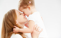 Happy family mother and  baby daughter hugging and kissing Stock Image