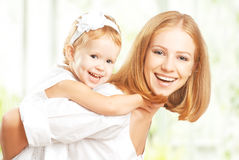 Happy family: mother and baby daughter hugging and laughing Stock Photos