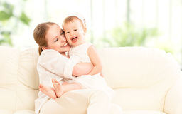 Happy family. Mother and baby daughter Stock Images
