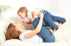 Happy family. Mother and baby daughter plays, hugging, kissing royalty free stock photos