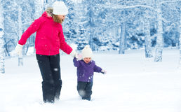 Happy family mother and baby girl daughter run, walk and playing Royalty Free Stock Photo