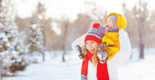 Happy family mother and baby is happy snow on winter walk. Happy family mother and baby is happy the snow on a winter nature walk Royalty Free Stock Photography