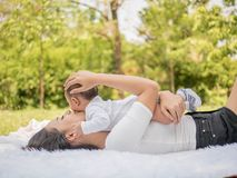 Happy family, Mother and baby hug and happy in the summer on the nature background.  stock photo