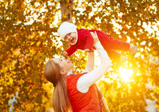 Happy family mother and baby laugh  in nature autumn Stock Image