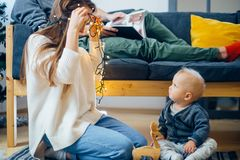 Happy family mother and baby little son playing home on Christmas holidays royalty free stock images