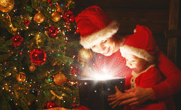 Happy family mother and baby with magical Christmas gift Stock Image