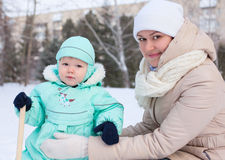 Happy family mother and baby in park in winter Royalty Free Stock Photography