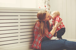 Happy family mother and baby playing at home Stock Images