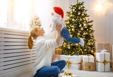 Family mother and baby son at Christmas morning at tree Royalty Free Stock Image