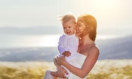 Happy family mother and baby son laughing  in nature Royalty Free Stock Photo
