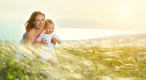 Happy family mother and baby son laughing  in nature Stock Photography