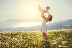Happy family mother and baby son laughing  in nature Royalty Free Stock Images