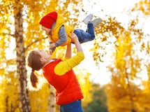 Happy family mother and baby son on autumn walk Royalty Free Stock Image