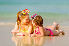 Happy family mother and chid daughter in masks on beach in summe Royalty Free Stock Image