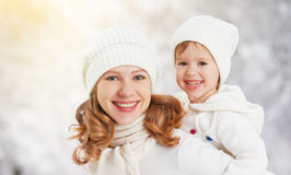 Happy family mother and child baby daughter on a winter walk Stock Photo