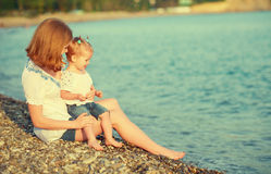 Happy family mother and child on  beach by  sea Royalty Free Stock Images