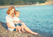 Happy family mother and child on  beach by  sea Royalty Free Stock Photos