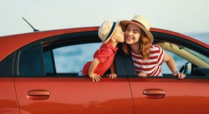 Happy family mother and child boy goes to summer travel trip in car royalty free stock images