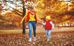 Happy family mother and child daughter on autumn walk Royalty Free Stock Photo