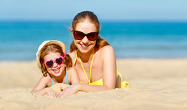 Happy family mother and child daughter  on beach in summer. Happy family mother and child daughter  for swimming on beach in summer Stock Photo