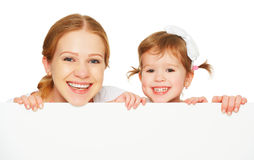 Happy family mother child daughter with blank white poster Royalty Free Stock Images