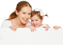 Happy family mother child daughter with blank white poster Royalty Free Stock Image