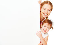 Happy family mother child daughter with blank white poster. Isolated Royalty Free Stock Photos