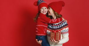 Happy family mother and child daughter with christmas gifts on r royalty free stock image