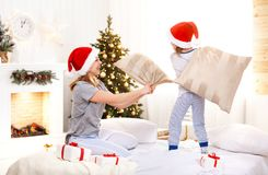 Happy family mother and child daughter  at christmas morning fig Royalty Free Stock Image