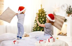 Happy family mother and child daughter  at christmas morning fig Stock Photo