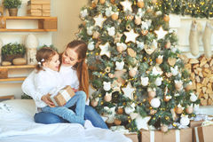 Happy family mother and child daughter on Christmas morning  tre Stock Image