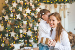 Happy family mother and child daughter on Christmas morning  tre Royalty Free Stock Image