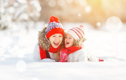 Happy family mother and child daughter having fun, playing at wi Royalty Free Stock Image