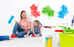 Happy family mother and child daughter making repairs, paint wal Stock Images