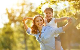 Happy family mother and child daughter in nature   in summer stock photography
