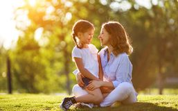 Happy family mother and child daughter in nature   in summer. Happy family mother and child daughter in nature Park in summer on green grass royalty free stock photography