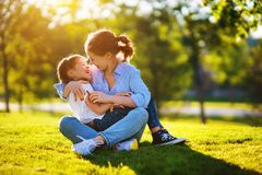 Happy family mother and child daughter in nature   in summer. Happy family mother and child daughter in nature Park in summer on green grass royalty free stock photos