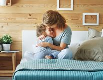 Happy family mother and child daughter laughing in bed Royalty Free Stock Images