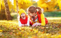 Happy family mother and child daughter on autumn walk Stock Images