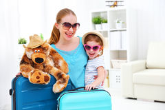 Happy family mother and child daughter suitcases packed for vaca Royalty Free Stock Photo