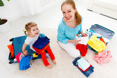 Happy family mother and child daughter suitcases packed for vaca Stock Photos