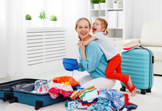 Happy family mother and child daughter suitcases packed for vaca Royalty Free Stock Photos